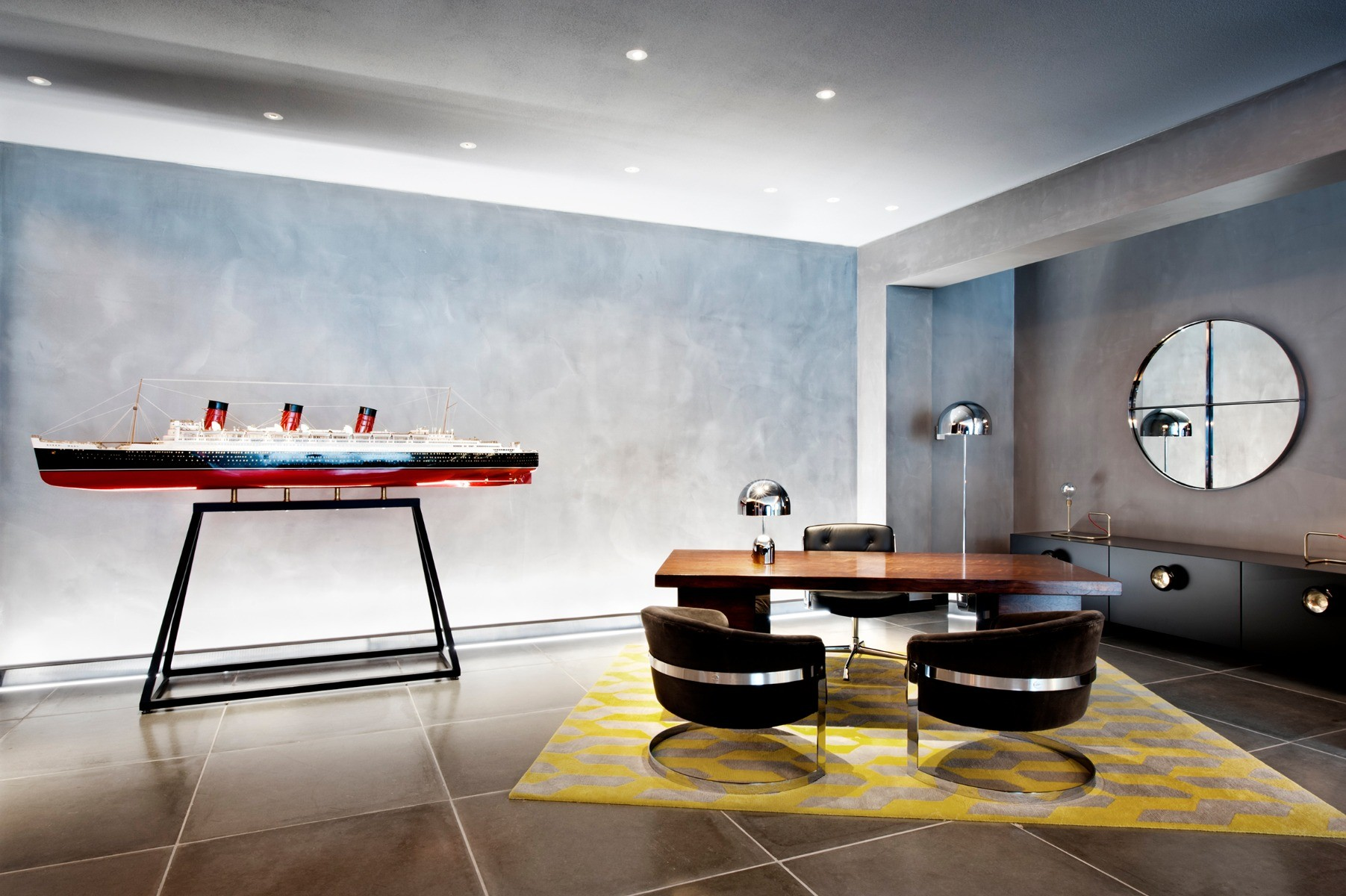 Mondrian Hotel in London, featuring a Bell table and floor lights. Interiors by Tom Dixon's Design Research Studio.