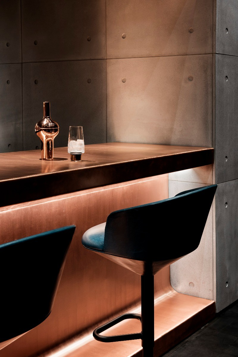 Tom Dixon Himitsu Bar in Atlanta featuring Pivot bar stools, Plum cocktail shaker and Tank glass.