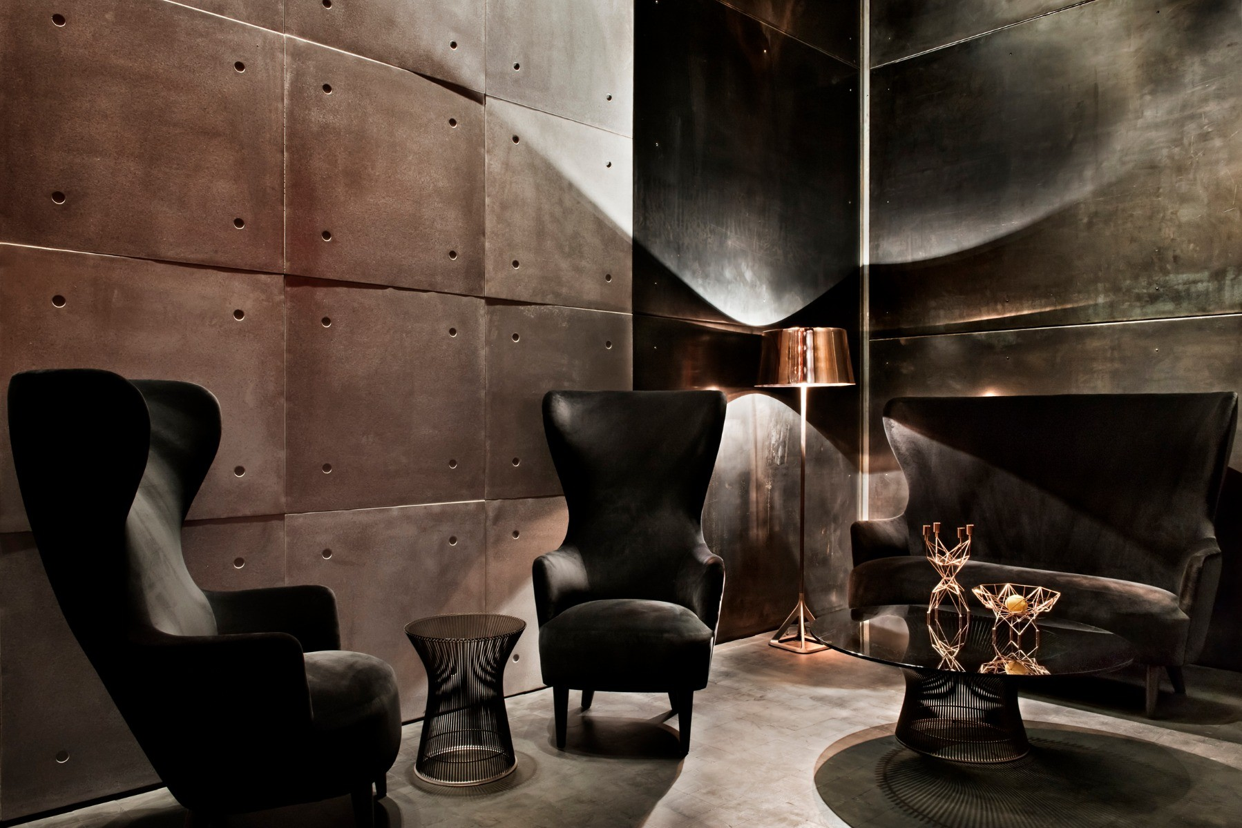 Tom Dixon Himitsu Bar in Atlanta featuring black velvet Wingback chairs and sofa, as well as a copper Base floor light and Pylon accessories.