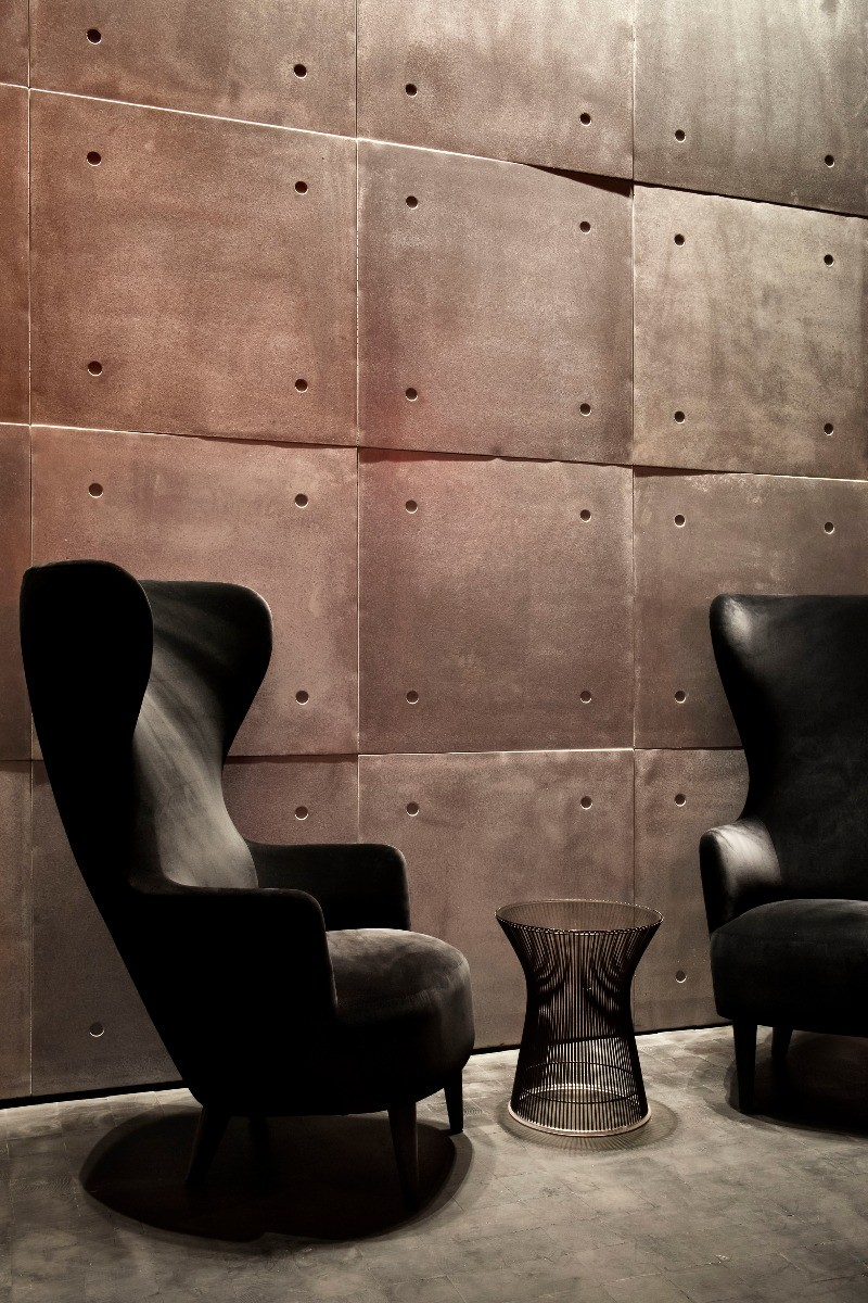 Tom Dixon Himitsu Bar in Atlanta featuring a black velvet Wingback Chair.