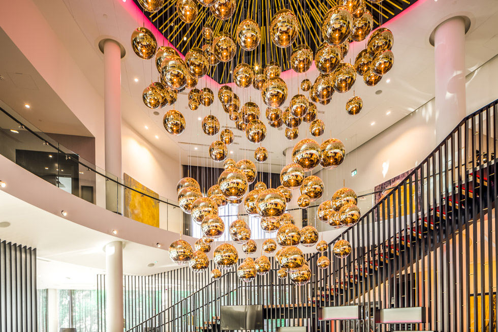 Tom Dixon MIRROR BALL arrangement in the lobby of the Hilton Estonia