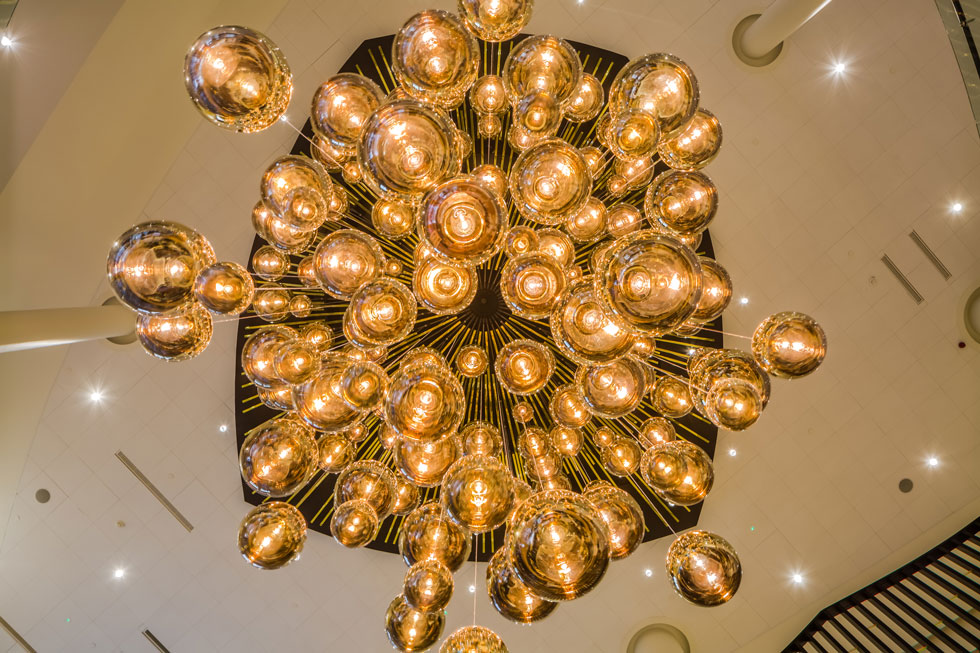 Tom Dixon lighting sculpture at the new Hilton Hotel in Estonia. Over 200 MIRROR BALL lights in this huge chandelier arrangement.