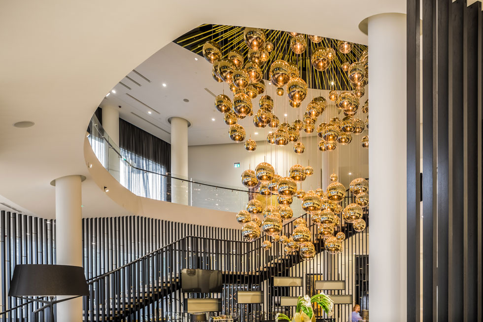 Tom Dixon lighting as featured in the hotel lobby of the new Hilton in Estonia. Here's the MIRROR BALL.