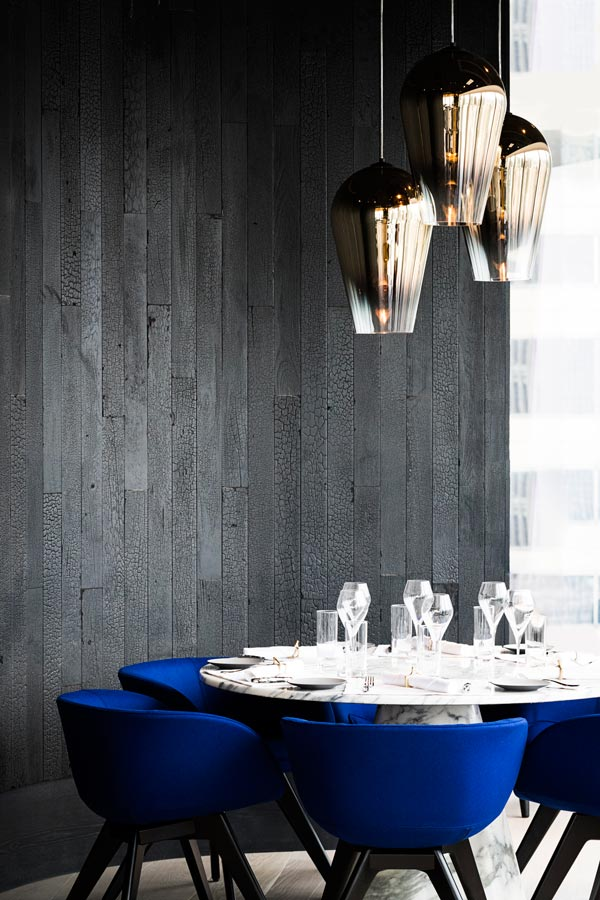 Tom Dixon has called upon the practice of alchemy and the four classical elements of earth, air, fire and water to create dramatic and striking interiors that bare the darker side of nature.