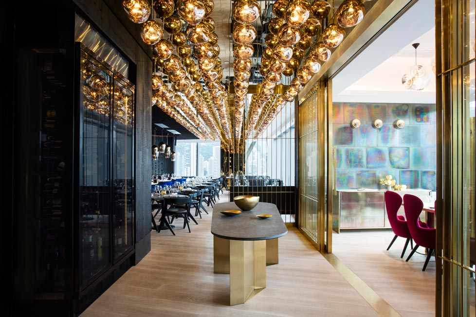 Tom Dixon Alto Restaurant in Hong Kong featuring an expansive canopy of 230 Melt Mini Gold lights.
