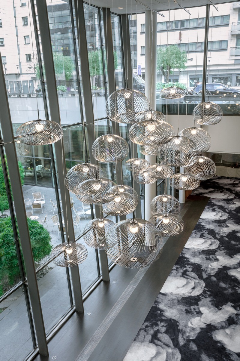 Tom Dixon's Spring Lights in the business centre of the Pullman Hotel