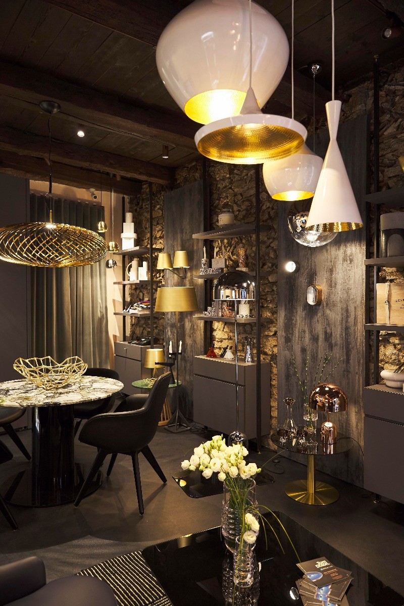 Interior view of Tom Dixon's Como Shop, featuring Beat Pendants, Spring Pendants, Scoop Chairs and Bone Bowl